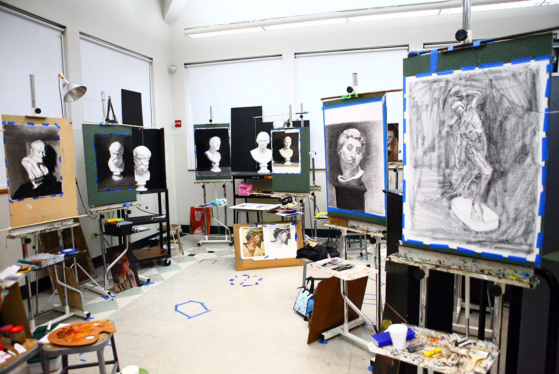 Art studio filled with easels and paintings