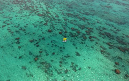 Aerial view of the WCC canoe in the ocean