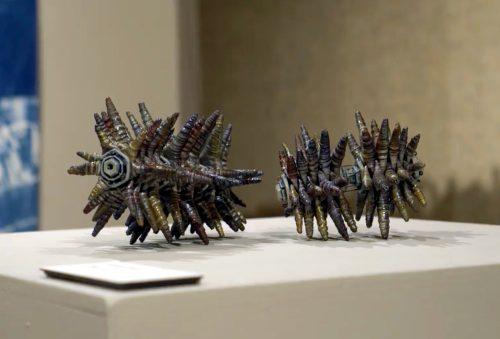 #136 by Christopher Edwards; Raku-fired ceramic, steel wire