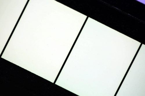 Warp & Weft by Brian Black; Computer-generated animation, recorded onto motion picture film. Then, printed film is laid out and mounted onto a custom-built light box for display