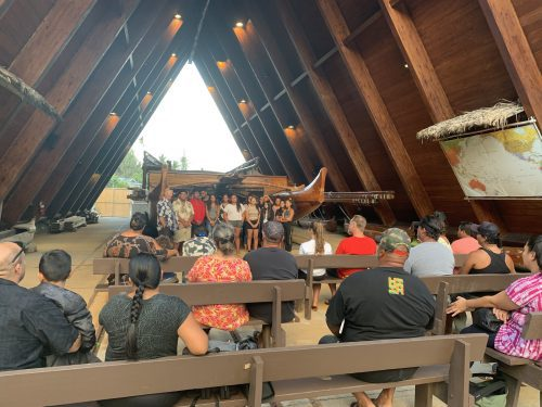 Students share what they have learned in a culminating activity for the waʻa course, where they prepare a presentation and meal for their families.